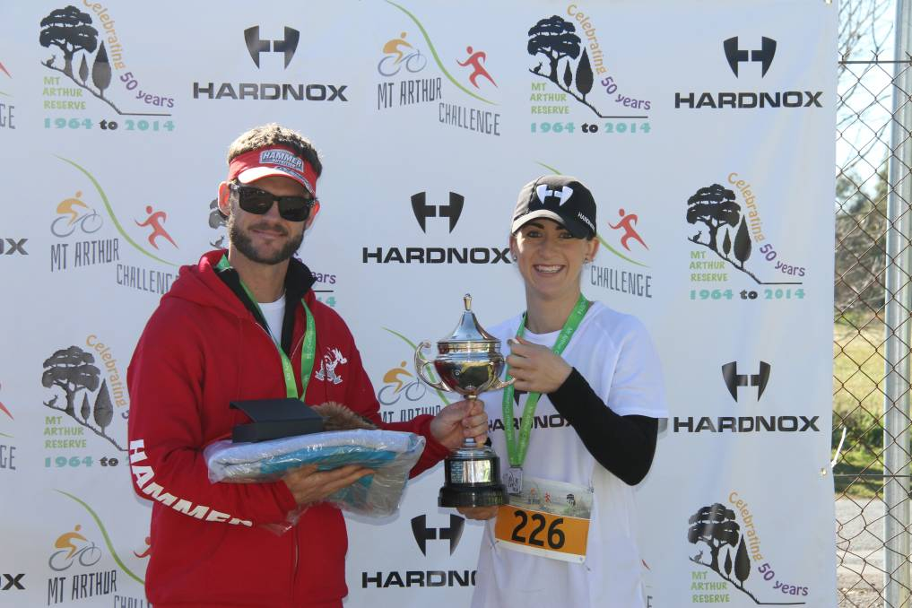 Mt Arthur Challenge winner Wes Gibson and Kellsey Melhuish who finished second in the 5km fun run and also with the Hardnox group was major sponsor.